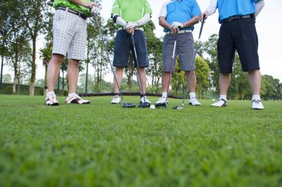 Image,Of,4,Male,Golfers,With,Drivers,And,A,White