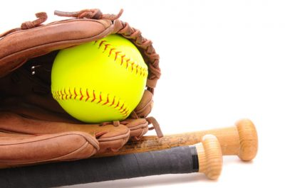 Closeup,Of,A,Softball,Glove,Ball,And,Two,Bats,On